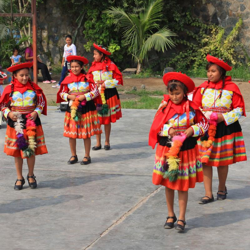 Children dancing in traditional Peruvian costumes