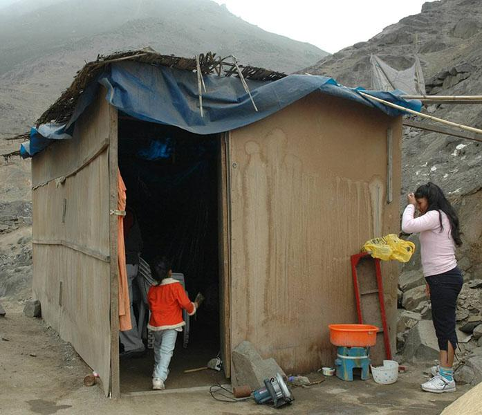 Home of young woman and child in Collique, Peru