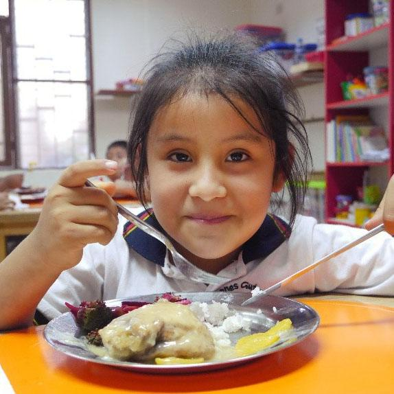 Young girl enjoying a wholesome lunch