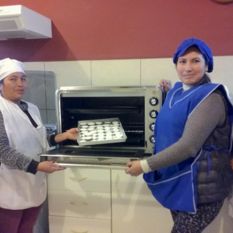 Showing off the oven at the bakery