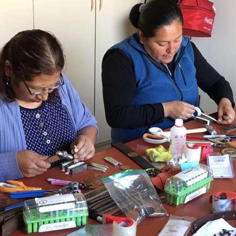 Women making bracelets with Collique Cuffs