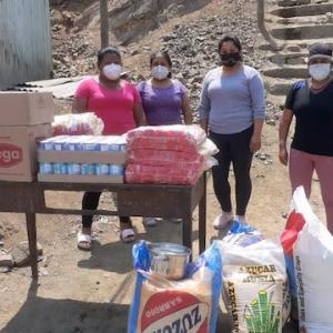 Delivery of food for soup kitchen in Collique, Peru