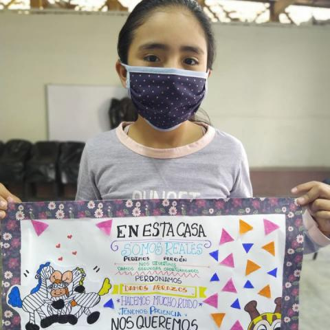OSA student with family poster