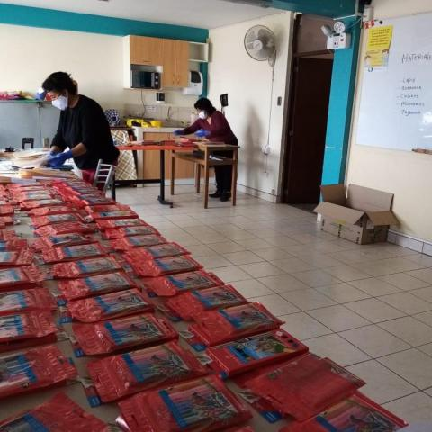 Preparing educational packets at OSA House